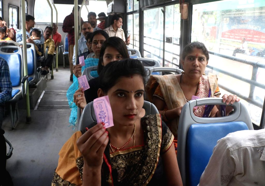 New Delhi: Women travelling in a DTC bus show their tickets as they travel free of cost after the scheme to provide free ride to women in DTC and cluster buses announced by the Delhi Government came into effect, on Oct 29, 2019. (Photo: IANS)
