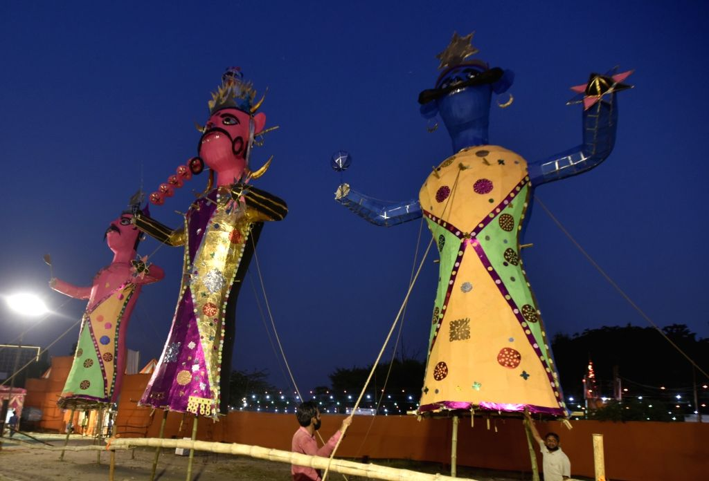 New Delhi:Workers give final touch to effigies of Ravana on the eve of the festival of Dussehra, in New Delhi,Thursday, Oct. 14, 2021.