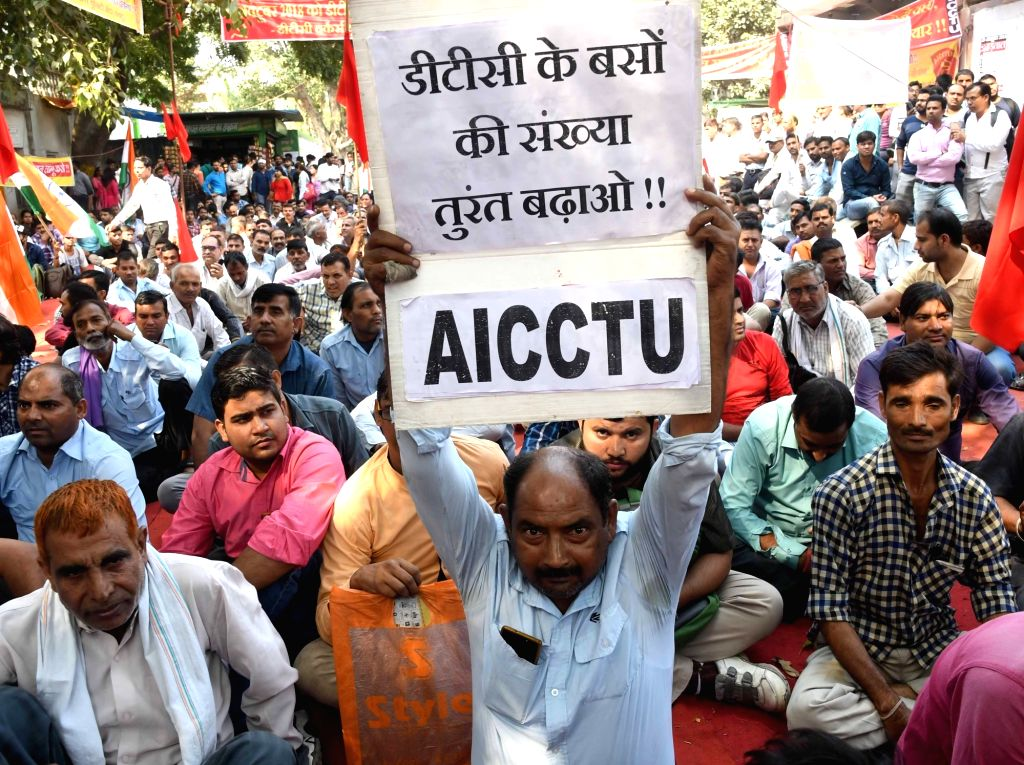 :New Delhi: Workers of Delhi Transport Corporation (DTC) under the banner of All India Central Council of Trade Unions (AICCTU) stage a demonstration to press for their various demands, in New ...