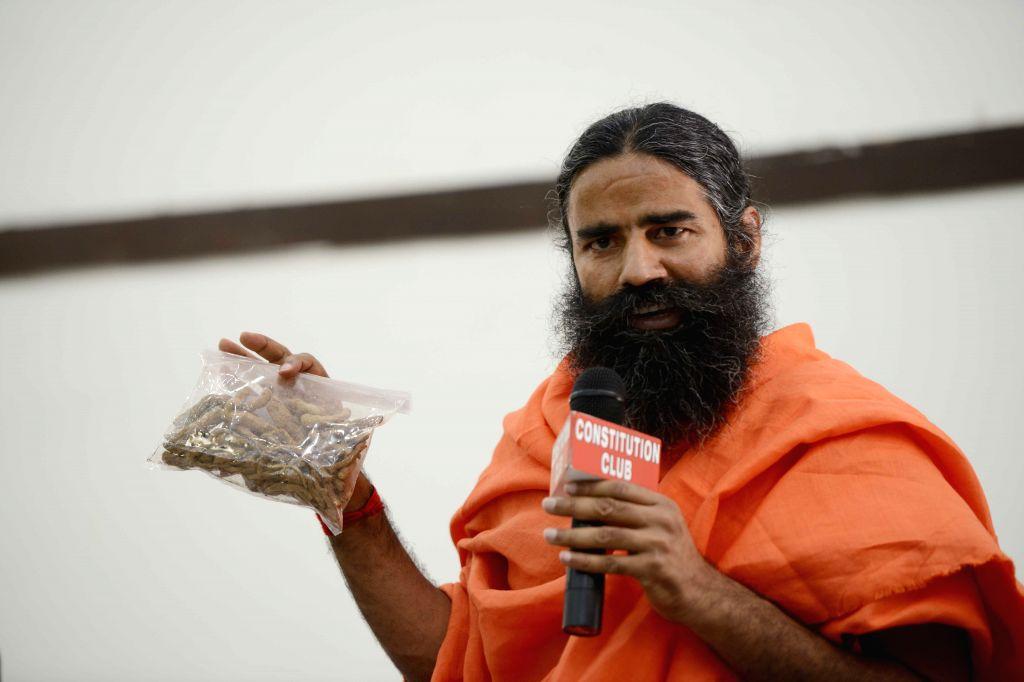 Yoga guru Baba Ramdev addresses during a press conference regarding `Divya Putrajeevak Seed` in New Delhi, on May 1, 2015.