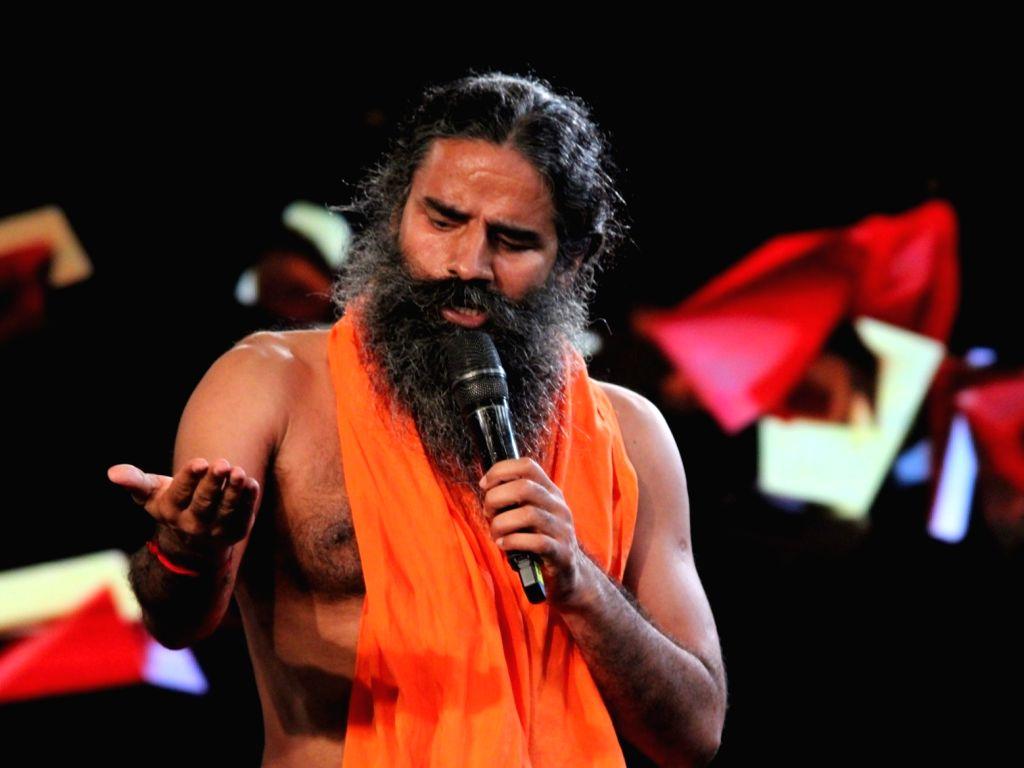 "New Delhi: Yoga Guru Baba Ramdev addresses during ""NDTV Yuva 2018"", in New Delhi on Sept 16, 2018. (Photo: Amlan Paliwal/IANS)"