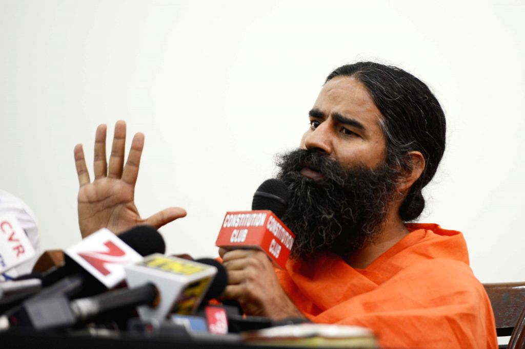 Yoga guru Ramdev addresses a press conference in New Delhi, on May 1, 2015.