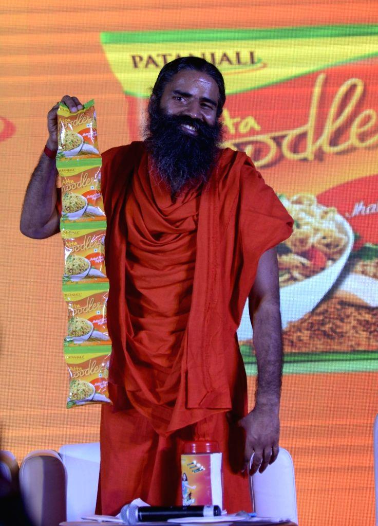 :New Delhi: Yoga Guru Ramdev launches Patanjali noodles in New Delhi on Nov 16, 2015. (Photo: IANS).