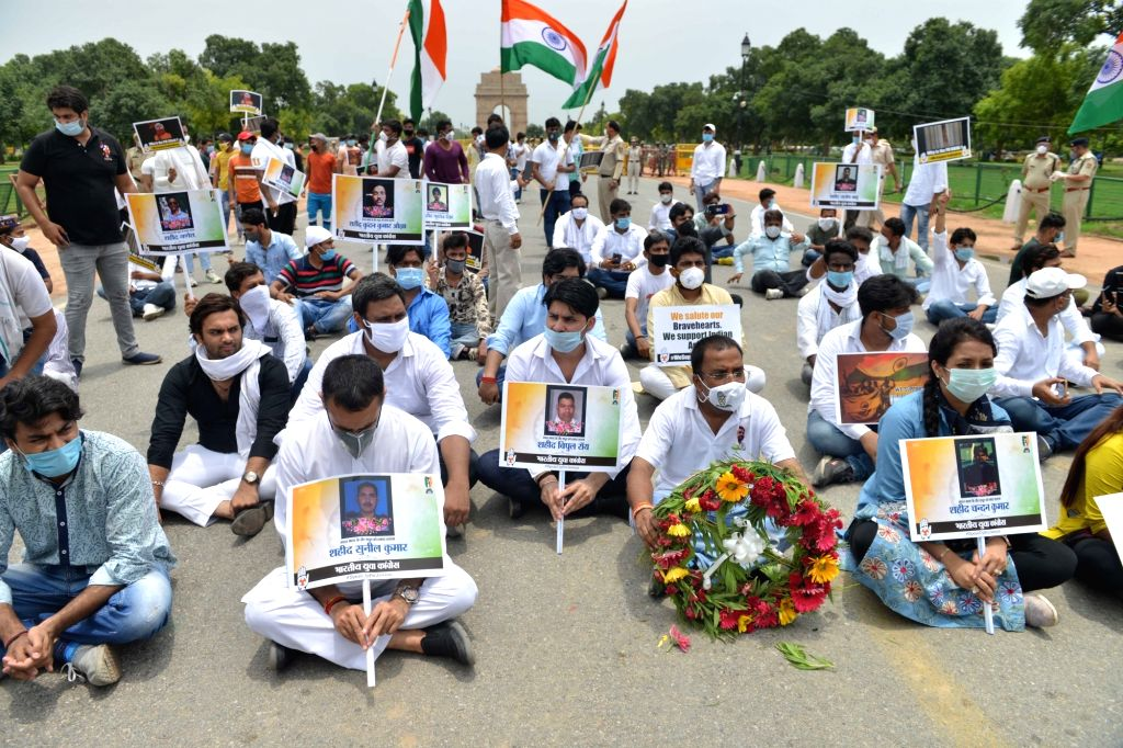 New Delhi: Youth Congress workers paying their tributes to the 20 Indian Army bravehearts who were martyred in a violent clash with the Chinese troops in the Galwan Valley in Eastern Ladakh; at India Gate in New Delhi on June 26, 2020. (Photo: IANS)