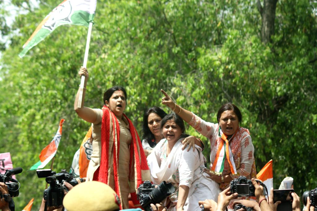 Youth Congress workers stage a demonstration against Union Minister of State for Micro, Small and Medium Enterprises Giriraj Singh's remark that the Congress accepted Sonia Gandhi as its ... - Enterprises Giriraj Singh and Sonia Gandhi