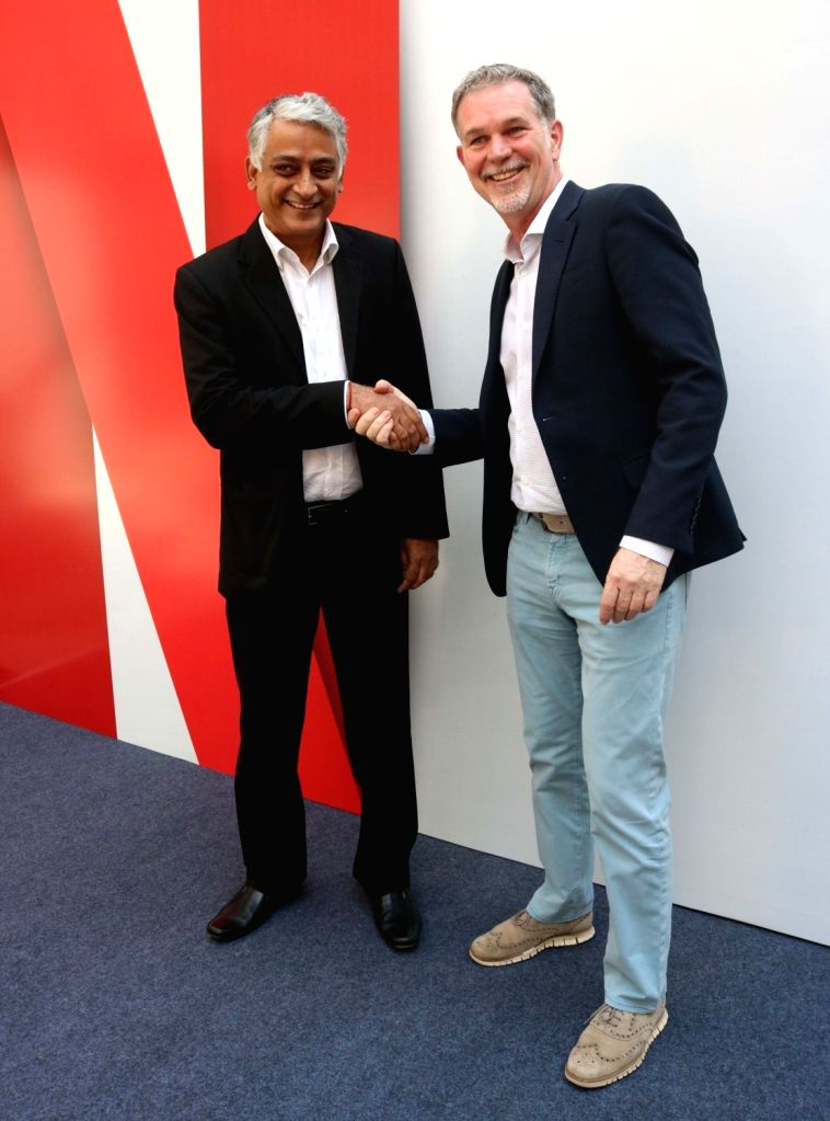 New Delhii: Netflix Co-founder and CEO Reed Hastings (R) with Videocon D2H COO Himanshu Patil (L) during a programme organised to announce Netflix's multi-platform partnership  in New Delhi on March ... - Himanshu Patil