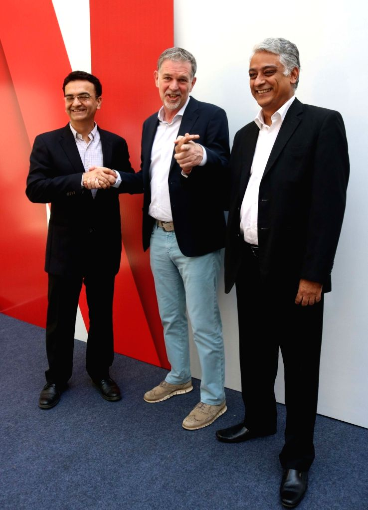 New Delhii: Netflix Co-founder and CEO Reed Hastings (C) with Vodafone India Director Commercial Sandeep Kataria (L) and Videocon D2H COO Himanshu Patil (R) during a programme organised to announce ... - Himanshu Patil