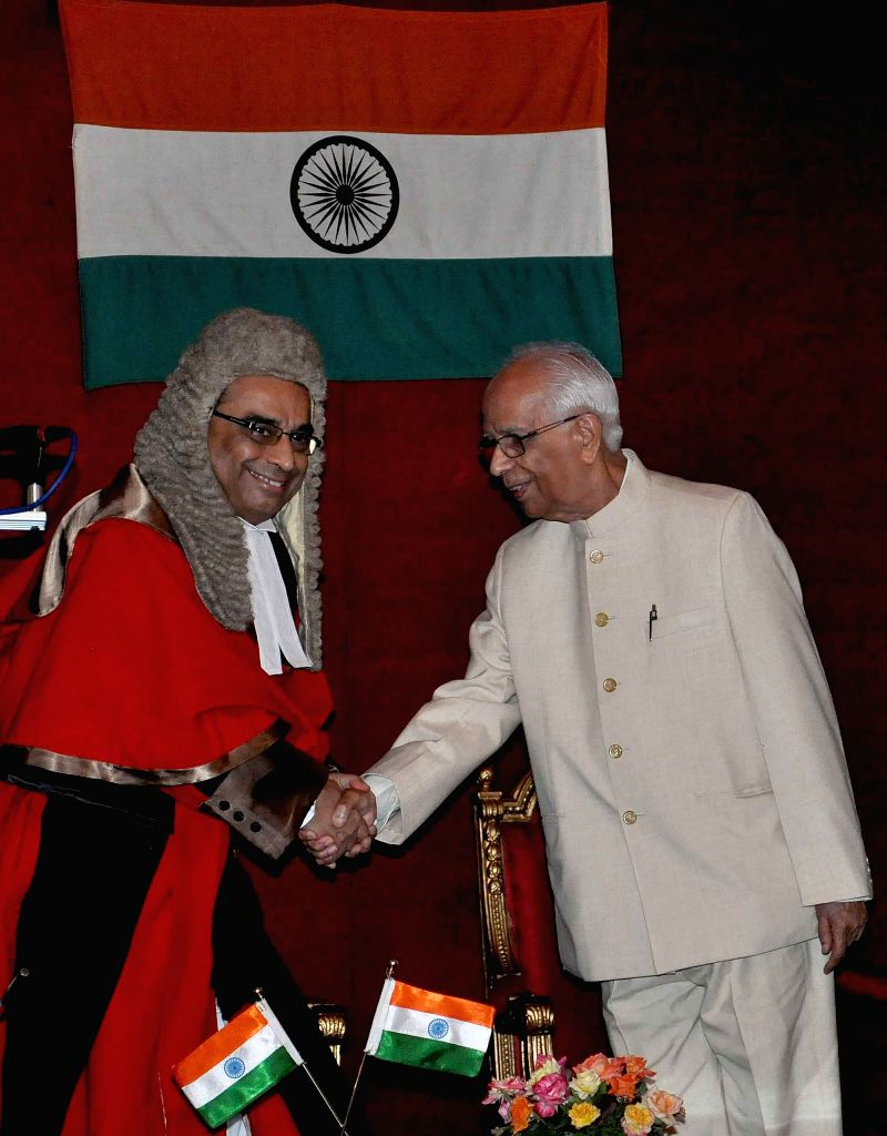New Governor of West Bengal Keshari Nath Tripathi and Senior Justice Ashim Banerjee during Governor`s oath taking ceremony at Raj Bhawan in Kolkata on July 24, 2014. - Ashim Banerjee