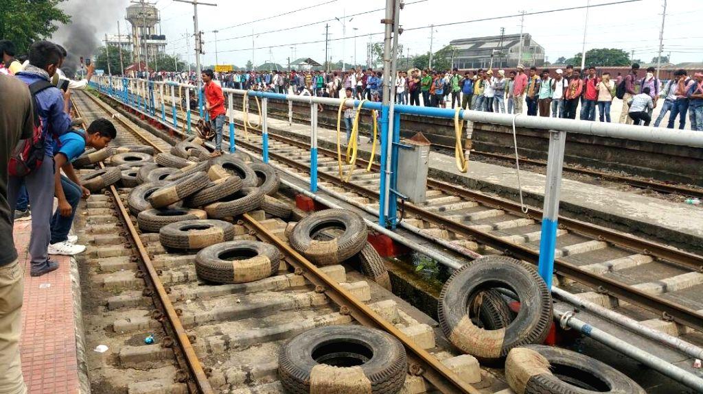 New Jalpaiguri: Tyres thrown on railway tracks by aspirants of Railway job at New Jalpaiguri Junction railway station on May 21, 2017. A section of aspirants became violent after their demands for a ...
