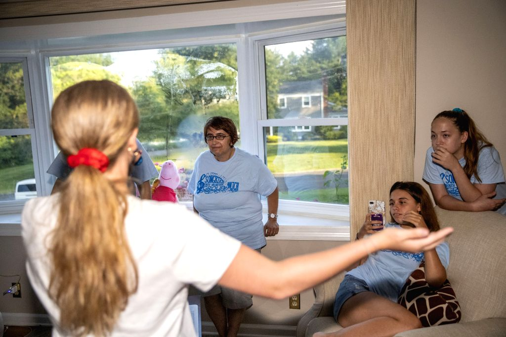 NEW JERSEY, Aug. 10, 2019 - Lynn Berat (3rd R) watches her daugher Lee (front) practice a Chinese song with her daughters Lindsay (2nd R) and Lane (1st R) at their Chinese teacher's house in Bernards ...