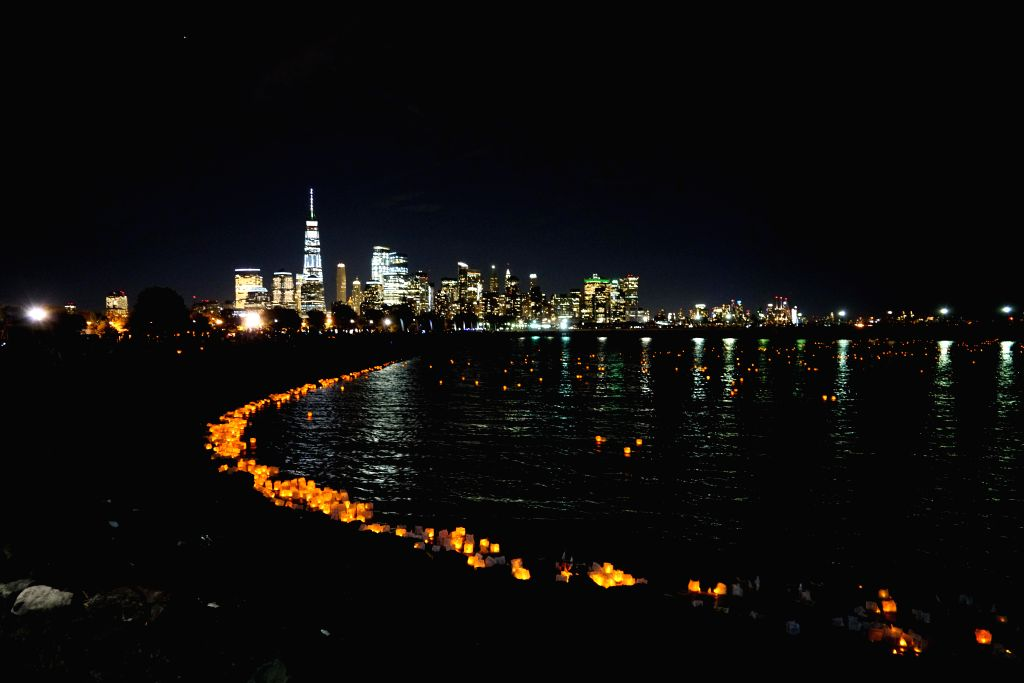NEW JERSEY, July 21, 2018 - Water lanterns float on the water during One World Water Lantern Festival at Liberty State Park in Jersey City, the United States, on July 20, 2018. More than 3,000 people ...