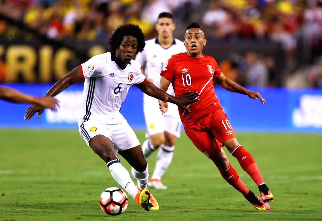 NEW JERSEY, June 18, 2016 - Carlos Sanchez (L) of Colombia vies with Christian Cueva of Peru during their quarterfinal match of 2016 Copa America soccer tournament at the Metlife Stadium in New ...