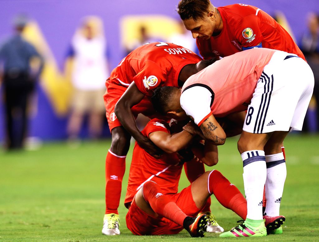 NEW JERSEY, June 18, 2016 - Christian Cueva (Bottom) of Peru is comforted by teammates as he cries after missing his shot in the penalty shootout after the quarterfinal match against Colombia of 2016 ...