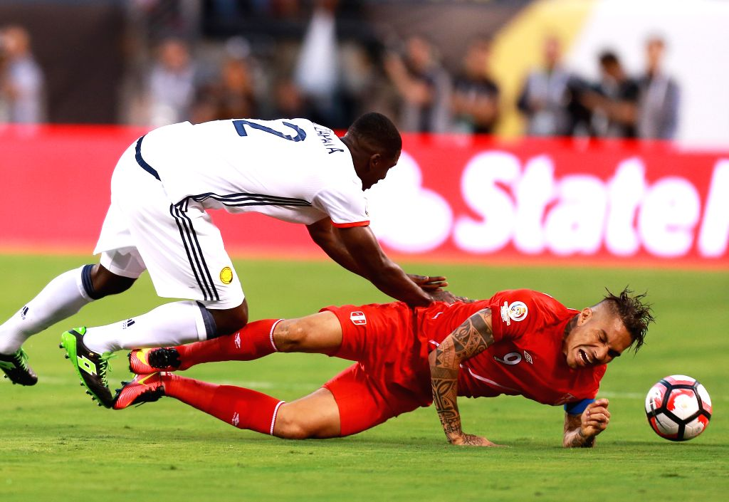 NEW JERSEY, June 18, 2016 - Cristian Zapata of Colombia vies with Jose Guerrero (R) of Peru during their quarterfinal match of 2016 Copa America soccer tournament at the Metlife Stadium in New ...