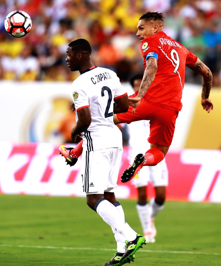 NEW JERSEY, June 18, 2016 - Jose Guerrero (R) of Peru vies with Cristian Zapata of Colombia during their quarterfinal match of 2016 Copa America soccer tournament at the Metlife Stadium in New ...