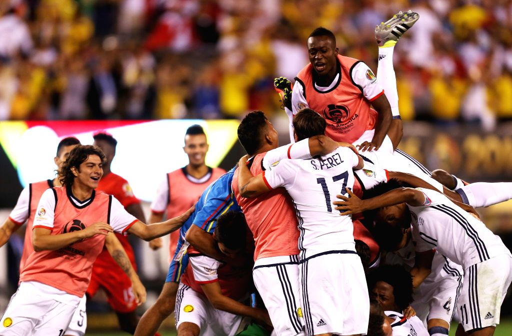 NEW JERSEY, June 18, 2016 - Players of Colombia celebrate after the quarterfinal match against Peru of 2016 Copa America soccer tournament at the Metlife Stadium in New Jersey, the United States, ...