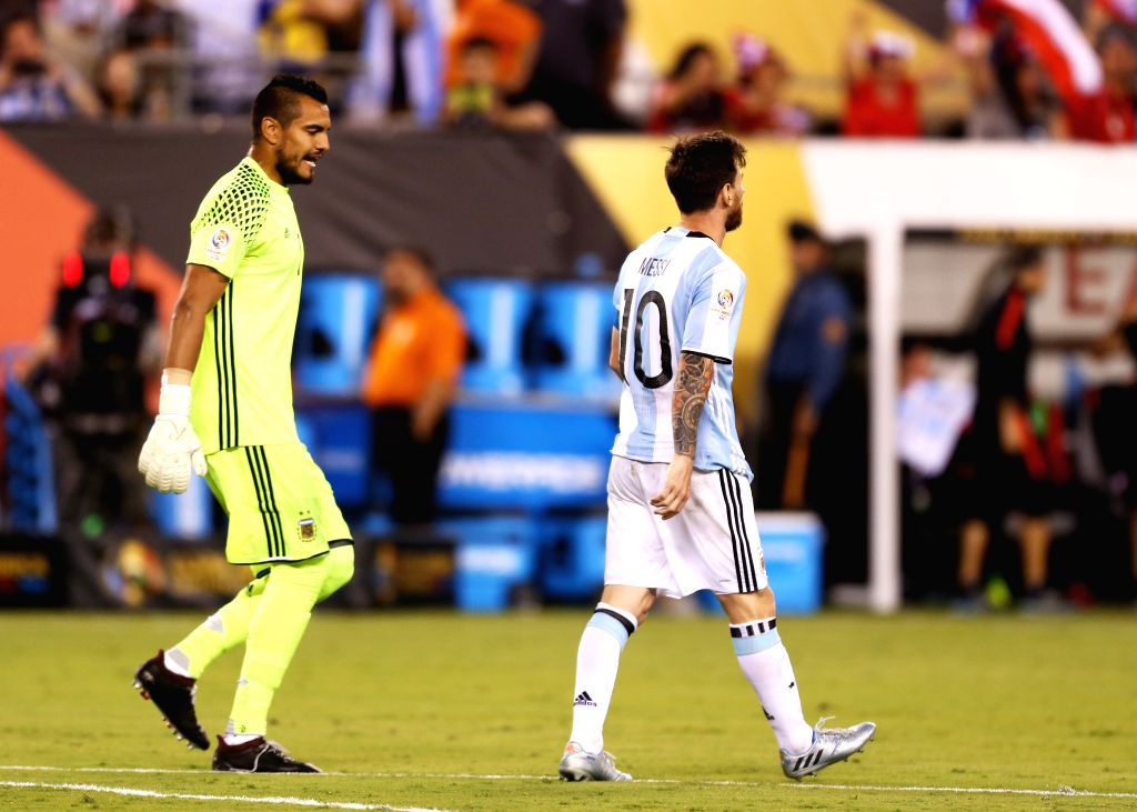 NEW JERSEY, June 27, 2016 - Argentina's Lionel Messi (R) reacts after missing a penalty kick during the penalty shootout of 2016 Copa America Centenario soccer tournament Final at the Metlife Stadium ...