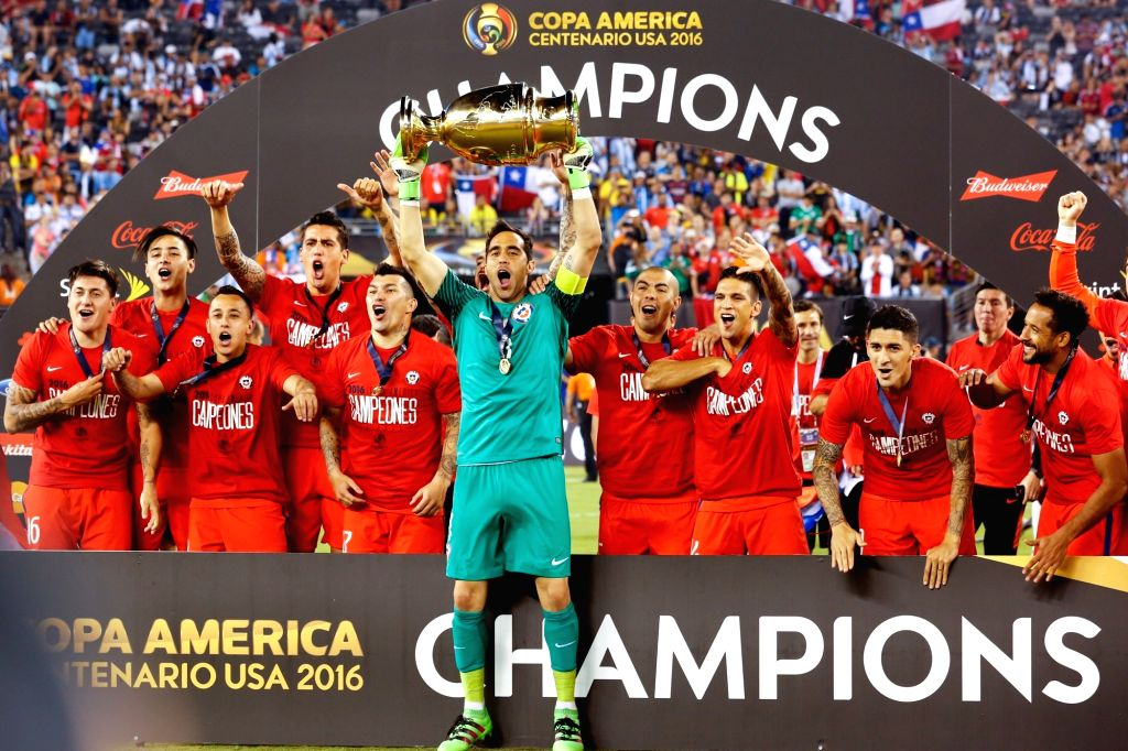 NEW JERSEY, June 27, 2016 - Claudio Bravo (front C), goalie of Chile and his teammates celebrate with the trophy after winning the final of 2016 Copa America Centenario soccer tournament at the ...