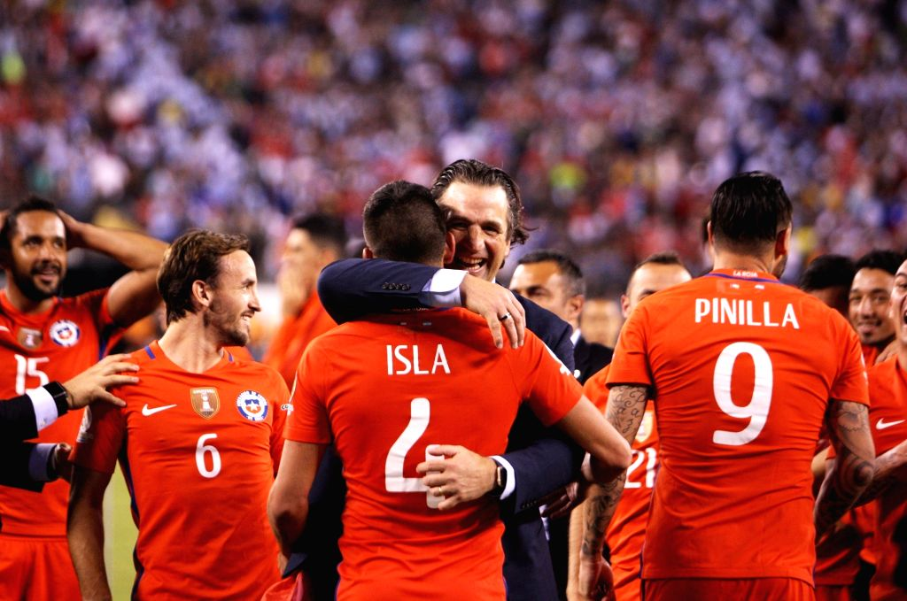 NEW JERSEY, June 27, 2016 - Juan Antonio Pizzi (R), head coach of Chile hugs with player Mauricio Isla to celebrate after winning the final of 2016 Copa America Centenario soccer tournament at the ...