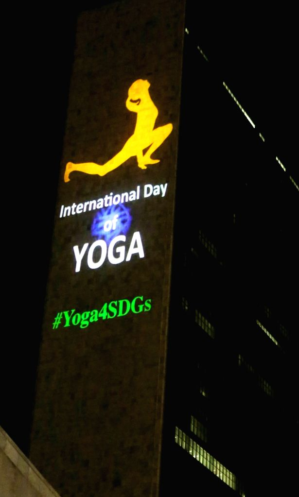New York: A photo projection depicting International Day of Yoga on the UN Secretariat Building in New York on June 20, 2016.