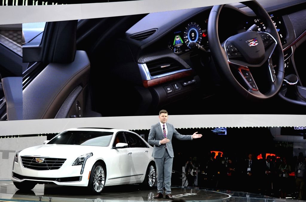 Andrew Smith, executive director of Cadillac global design, introduces CT6 at New York International Auto Show in New York, the United States, on April 1, 2015. ...