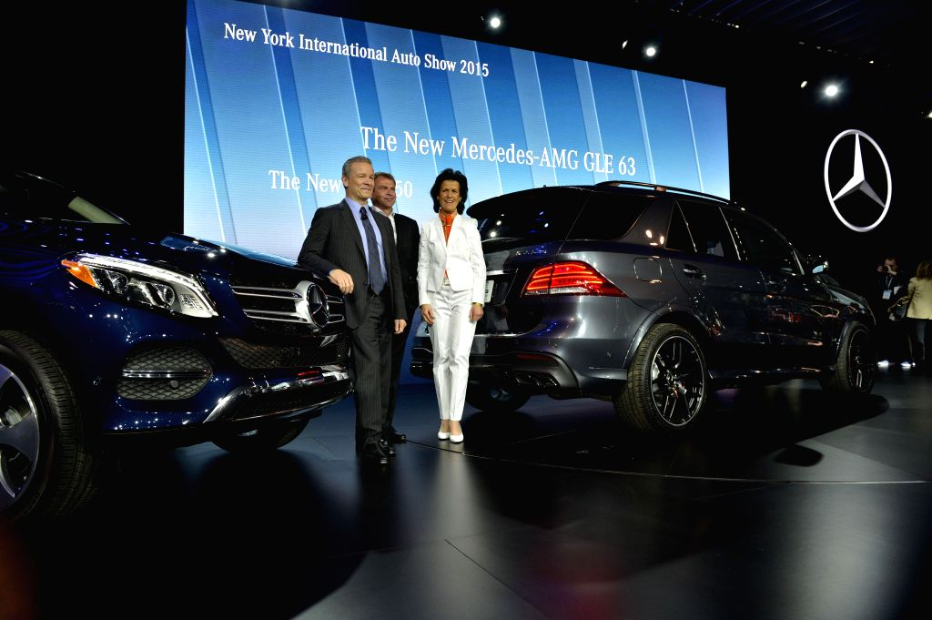 Tobias Moers (L), chairman of the Board of Management of Mercedes-AMG GmbH, unveils the new plug-in hybrid variant of BENZ GLE SUV at the New York International ...