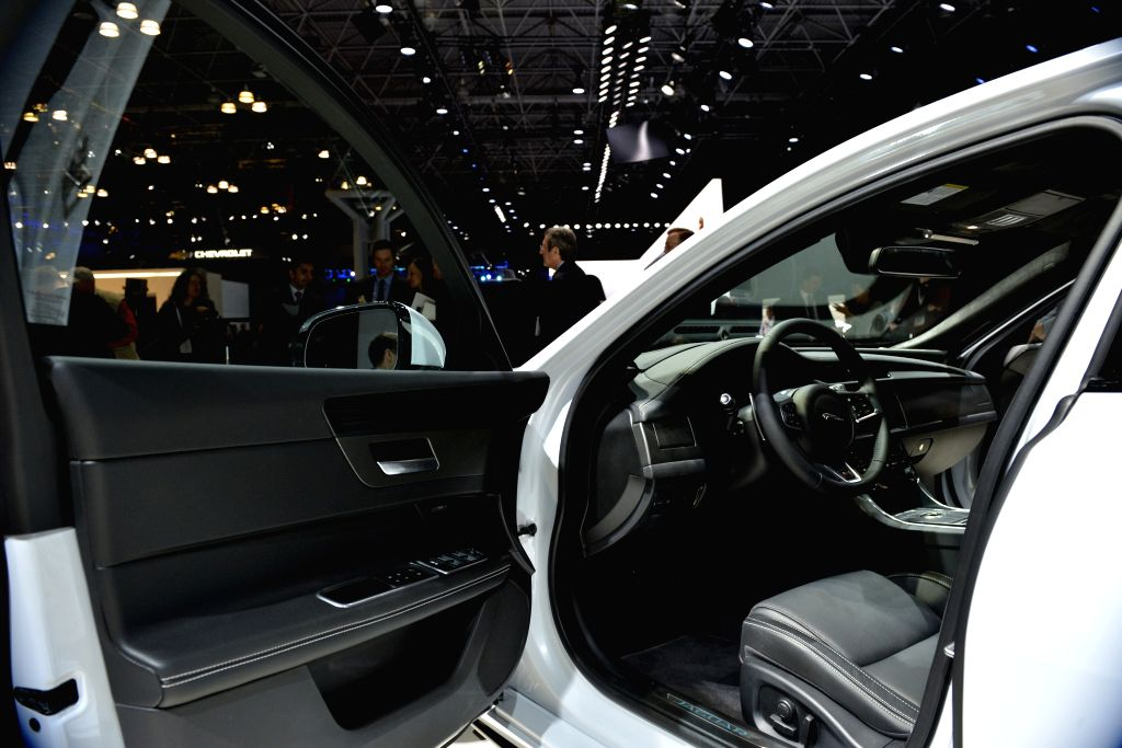 Visitors look at the new Jaguar XF at the New York International Auto Show in New York, the United States, on April 1, 2015. Mercedes-Benz, Jaguar, Ford, Aston ...