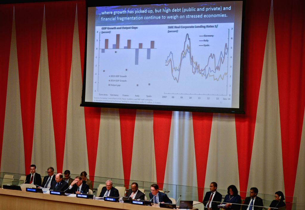 Thomas Helbling (5th R), chief of the World Economic Studies division at IMF's Research Department, speaks during a special high-level meeting of the United ...