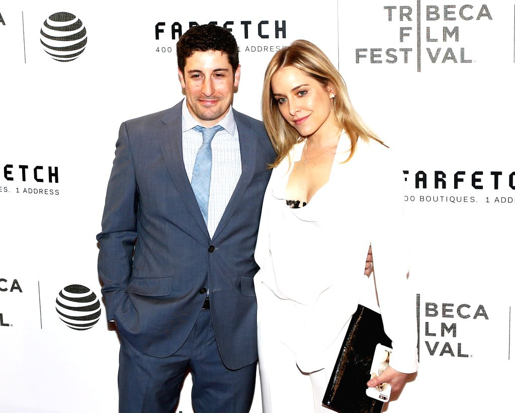 NEW YORK, April 14, 2016 - American actor Jason Biggs and his wife Jenny Mollen pose on the red carpet for the opening night of 2016 Tribeca Film Festival in New York, the United States on April 13, ... - Jason Biggs