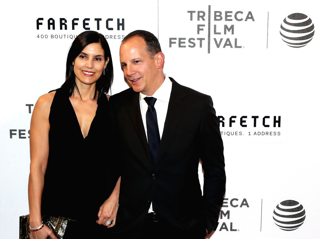 NEW YORK, April 14, 2016 - CEO of Tribeca Enterprises Andrew Essex(R) poses on the red carpet for the opening night of 2016 Tribeca Film Festival in New York, the United States on April 13, 2016. ...