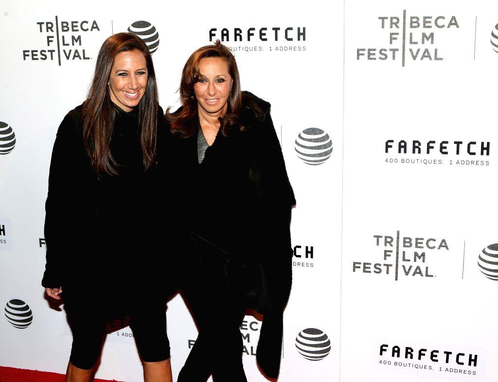 NEW YORK, April 14, 2016 - Designer Donna Karen (R) and her daughter Mark Karen pose on the red carpet for the opening night of 2016 Tribeca Film Festival in New York, the United States on April 13, ...