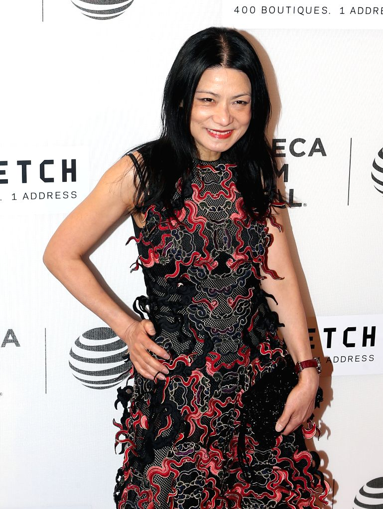 NEW YORK, April 14, 2016 - Designer Vivienne Tam poses on the red carpet for the opening night of 2016 Tribeca Film Festival in New York, the United States on April 13, 2016. 2016 Tribeca Film ...