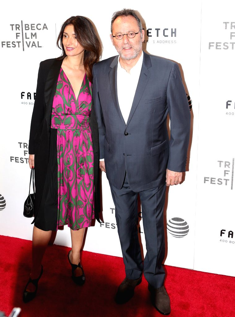 NEW YORK, April 14, 2016 - French actor Jean Reno and his wife Zofia Borucka pose on the red carpet for the opening night of 2016 Tribeca Film Festival in New York, the United States on April 13, ... - Jean Reno