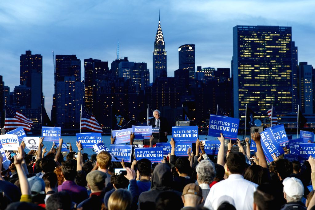 NEW YORK, April 19, 2016 - People attend a campaign rally of Democratic Presidential Candidate Bernie Sanders on the eve of the New York primary, in Long Island, New York, the United States, April ...