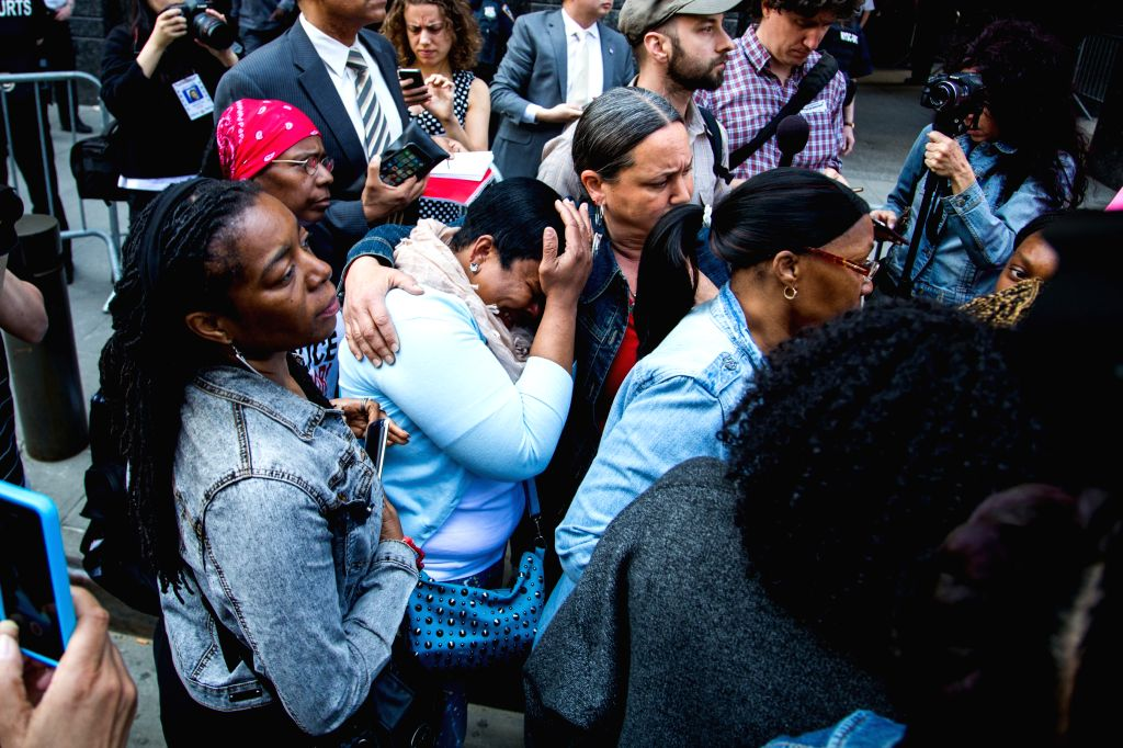 NEW YORK, April 20, 2016 - Friends and family members of Akai Gurley cry while leaving the courtroom after the sentencing of former NYPD officer Peter Liang in Brooklyn, New York, the United States, ...