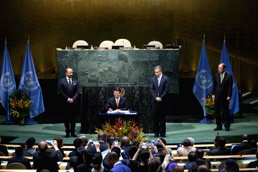 NEW YORK, April 22, 2016 - Zhang Gaoli, Chinese vice premier and special envoy of President Xi Jinping, signs the Paris Agreement on climate change as he attends the High-Level Event for the ...