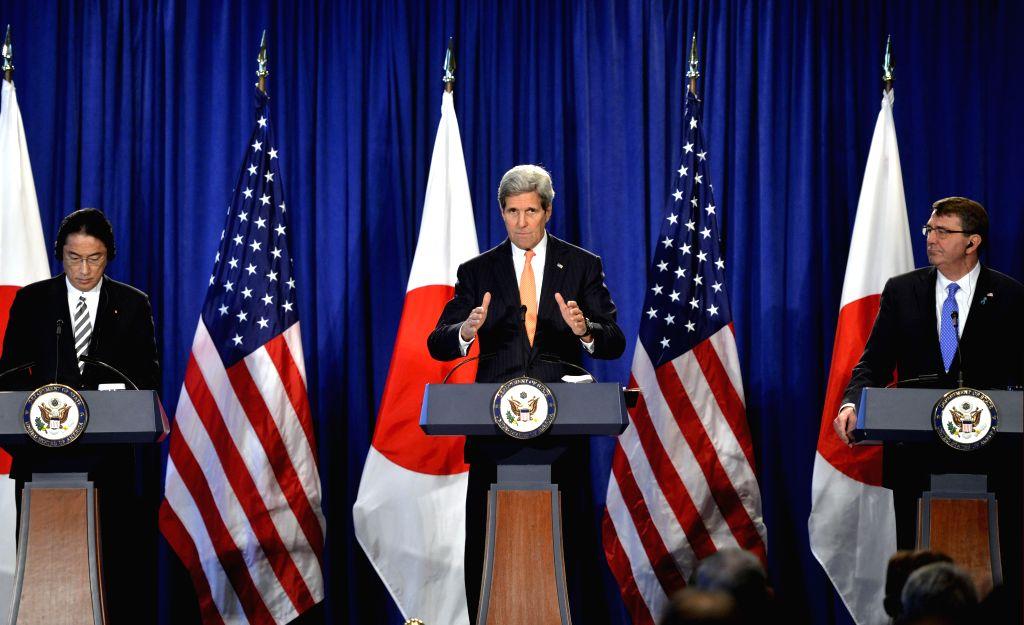 (R to L) U.S. Defense Secretary Ashton Carter, U.S. Secretary of State John Kerry and Japanese Foreign Minister Fumio Kishida attend a press conference in New ... - Fumio Kishida