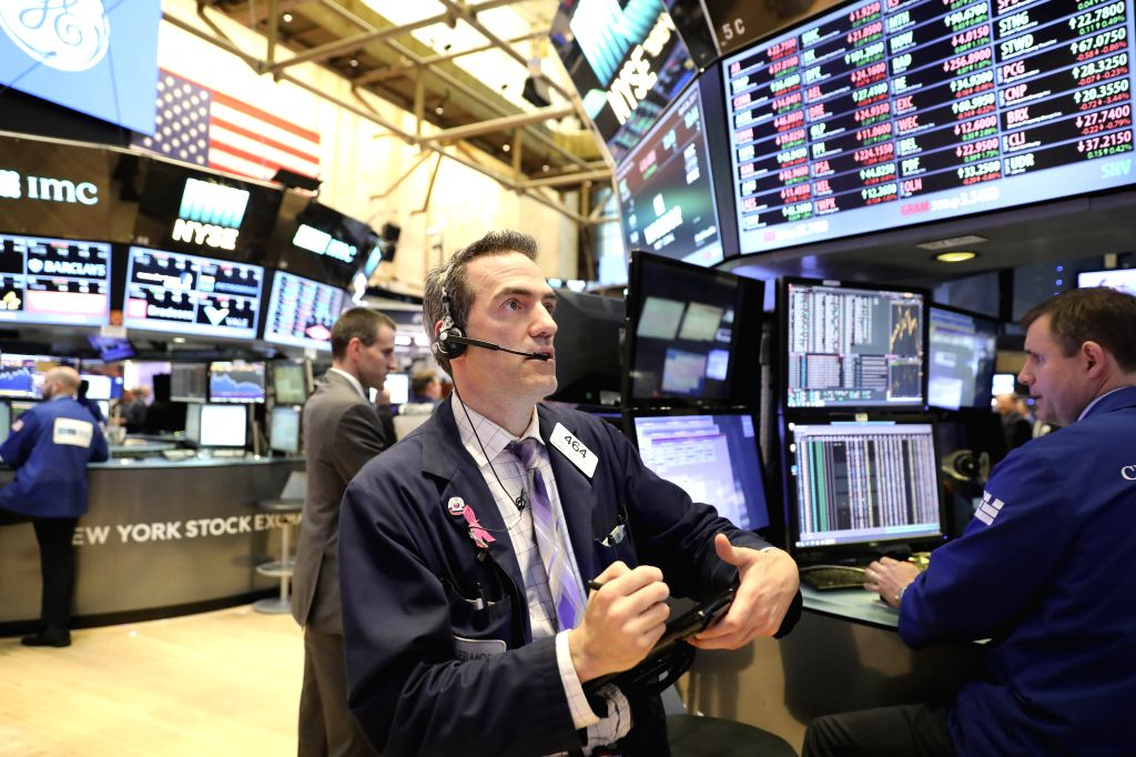NEW YORK, April 27, 2017 - Traders work at the New York Stock Exchange in New York, the United States, on April 26, 2017. U.S. stocks closed down Wednesday after the Trump administration announced ...