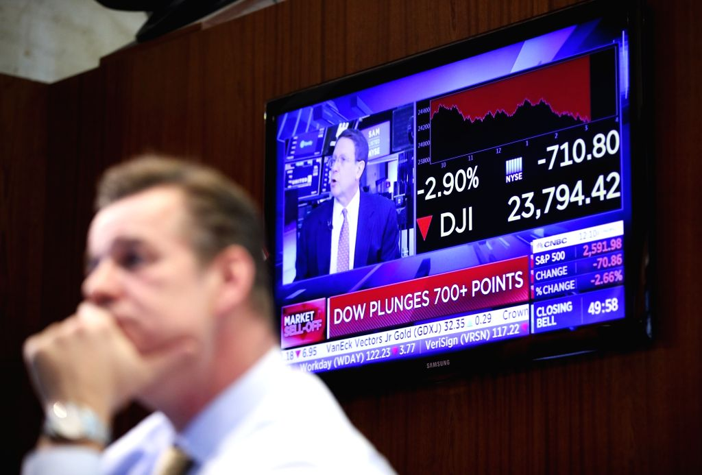 NEW YORK, April 6, 2018 - A screen shows the market news at the New York Stock Exchange in New York, the United States, on April 6, 2018. The Dow Jones Industrial Average erased 572.46 points, or ...