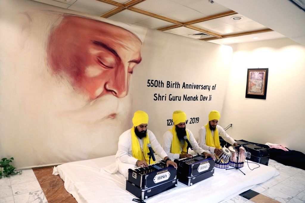 New York: Artistes perform during the 550th birth anniversary celebrations of Guru Nanak Dev in New York, US on Nov 12, 2019. - Nanak Dev