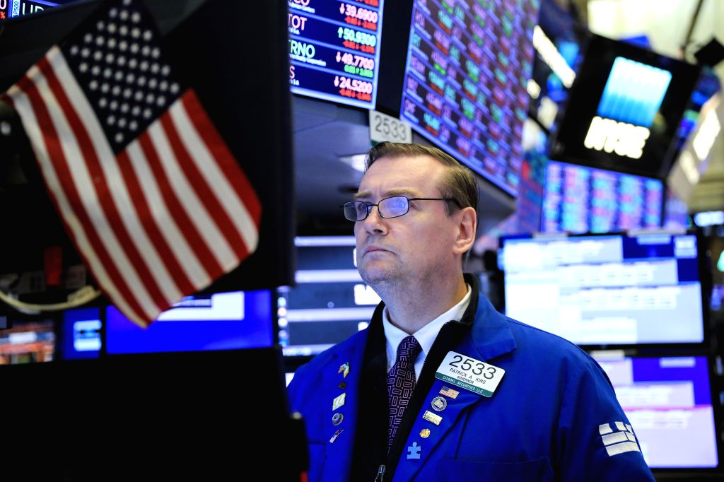 NEW YORK, Aug. 1, 2019 - A trader works at the New York Stock Exchange in New York, the United States, Aug. 1, 2019. U.S. stocks ended lower on Thursday, as investors digested a batch of negative ...
