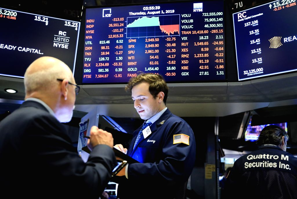 NEW YORK, Aug. 1, 2019 - Traders work at the New York Stock Exchange in New York, the United States, Aug. 1, 2019. U.S. stocks ended lower on Thursday, as investors digested a batch of negative data ...