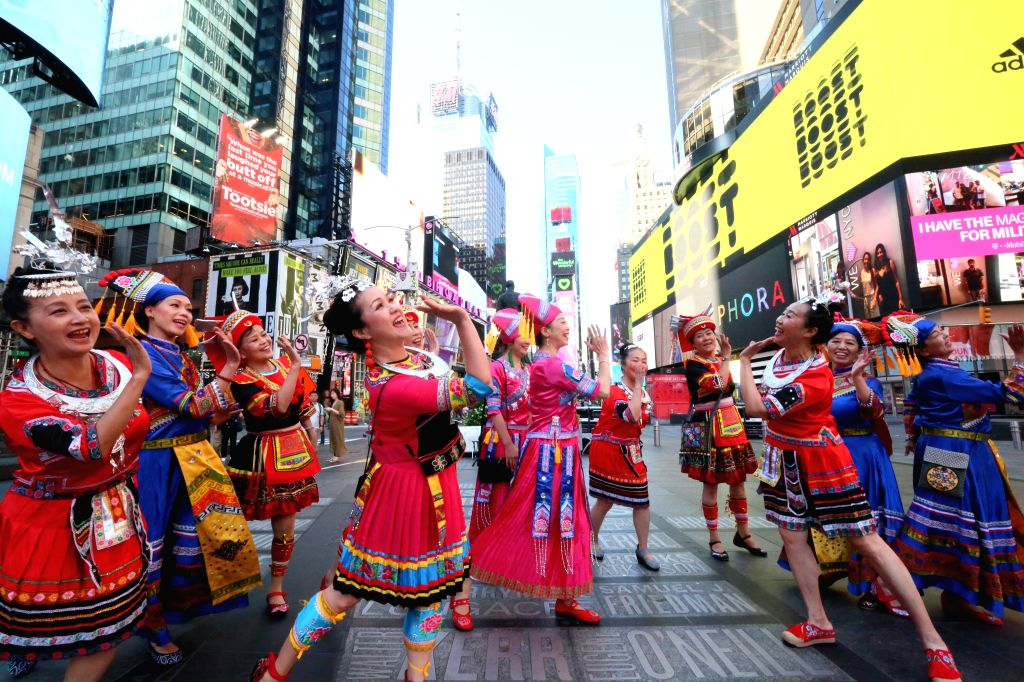 NEW YORK, Aug. 10, 2019 - People wearing Chinese folk costumes sing Chinese folk song at Times Square of New York, the United States, on Aug. 10, 2019.