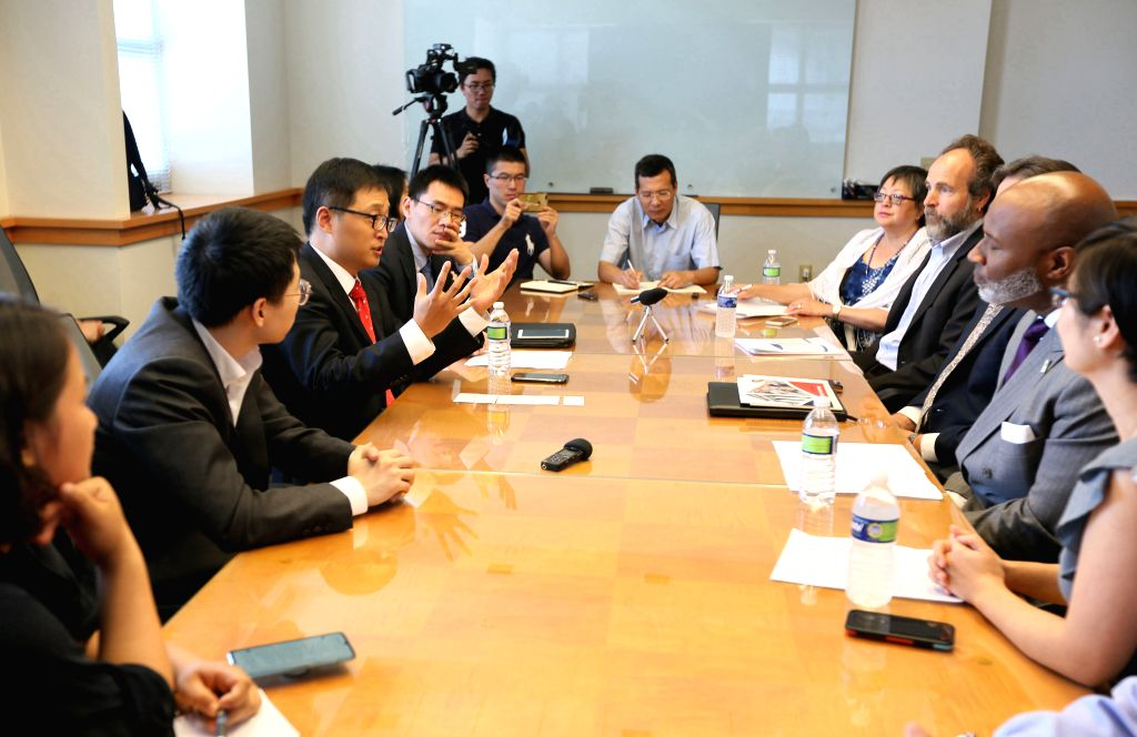 NEW YORK, Aug. 2, 2019 - Deputy Chinese Consul General in New York Qian Jin (3rd, L) speaks during a meeting in Cincinnati, Ohio, the United States, on July 25, 2019. Government officials, business ...