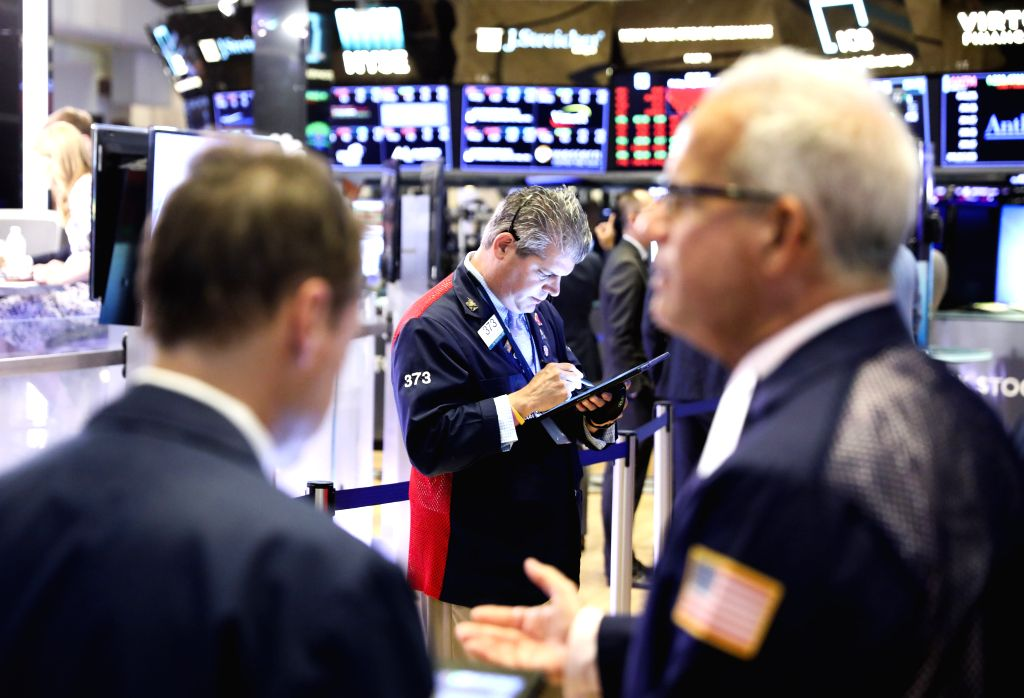 NEW YORK, Aug. 2, 2019 - Traders work at the New York Stock Exchange in New York, the United States, Aug. 2, 2019. U.S. stocks ended lower on Friday, as investors digested a batch of economic data ...