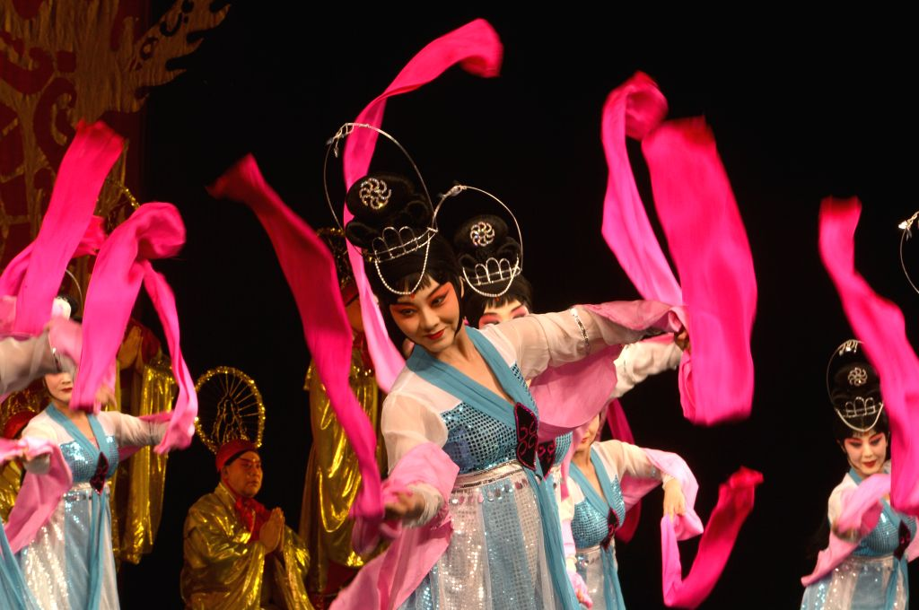 """Actresses perform Peking Opera """"The Goddess of Heaven Scatters Flowers"""" during a preview for media at Lincoln Center in New York City, the United States,"""