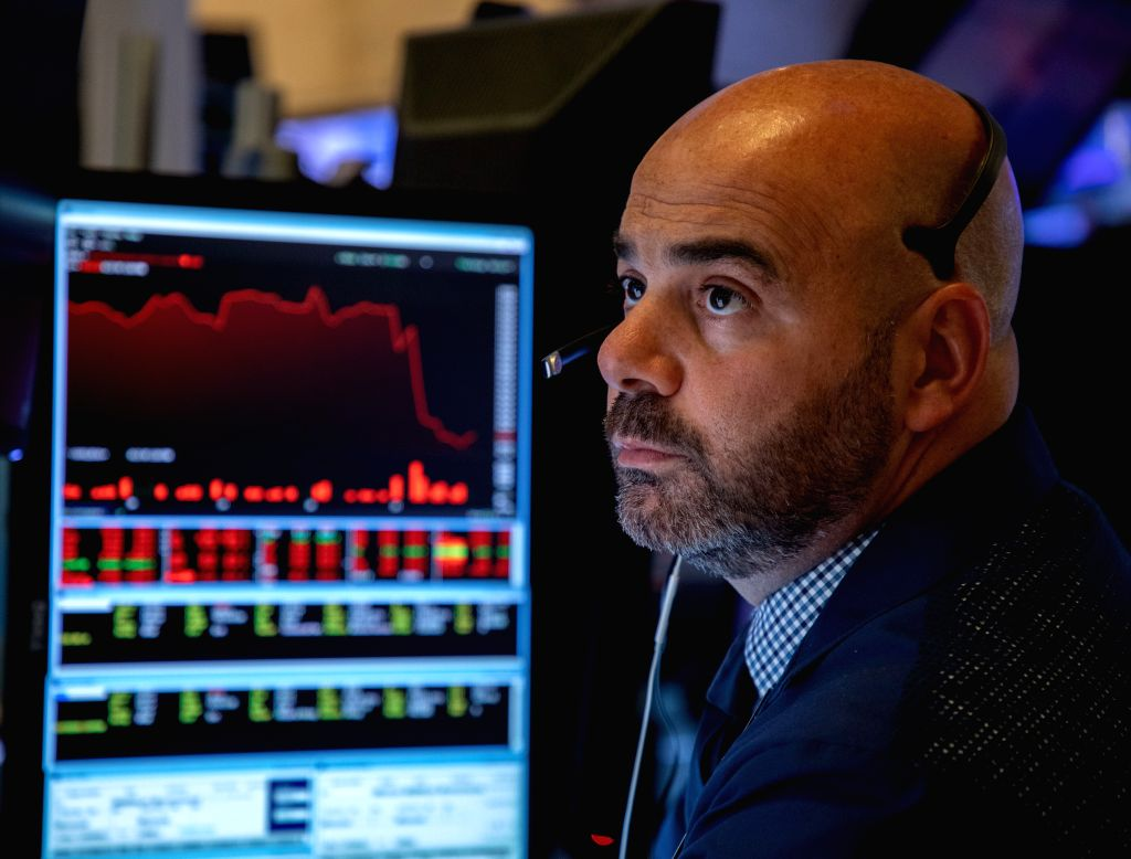 NEW YORK, Aug. 23, 2019 - A trader works at the New York Stock Exchange in New York, the United States, on Aug. 23, 2019. U.S. Stocks closed sharply lower on Friday after China announced its ...