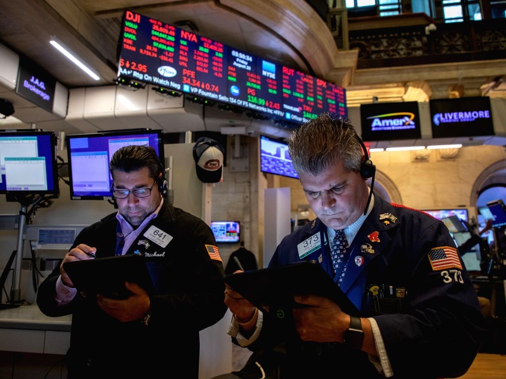 NEW YORK, Aug. 23, 2019 - Traders work at the New York Stock Exchange in New York, the United States, on Aug. 23, 2019. U.S. Stocks closed sharply lower on Friday after China announced its ...