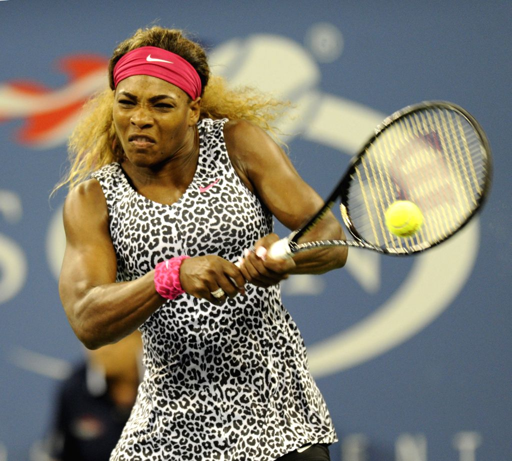 Serena Williams of the United States returns a shot to her compatriot Taylor Townsend during the first round match of women's singles at the 2014 U.S.Open in New ..