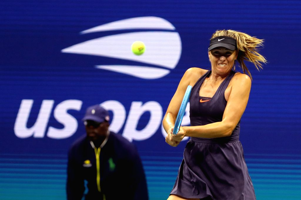 NEW YORK, Aug. 27, 2019 - Maria Sharapova of Russia hits a return during the women's singles first round match between Serena Williams of the United States and Maria Sharapova of Russia at the 2019 ...